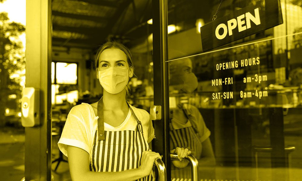 Cafe_Owner_Opening_To_Customers_Smiling