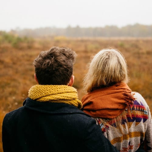 Man and a women standing in a field