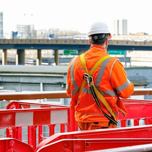 Back view of a construction worker walking into a building site - cis tax advice image