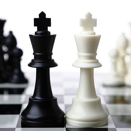 Black and white chess kings on chess boards - Corporate Finance image