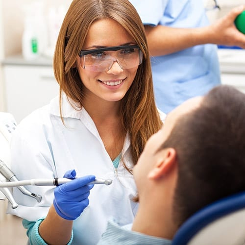 Dental accounting dental consultant checking a patient