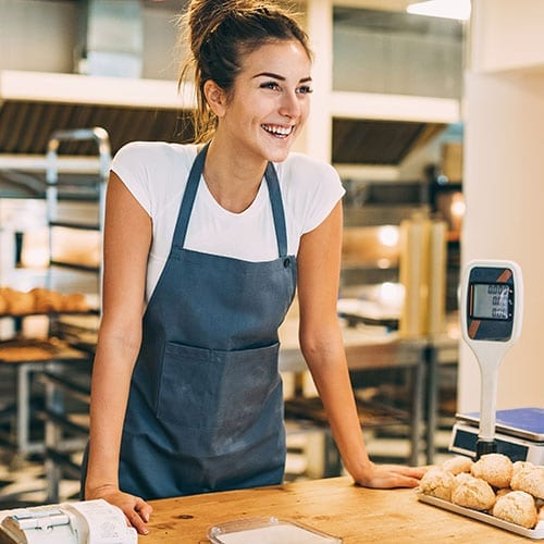 Food and drink image - small business owner serving in her bakery
