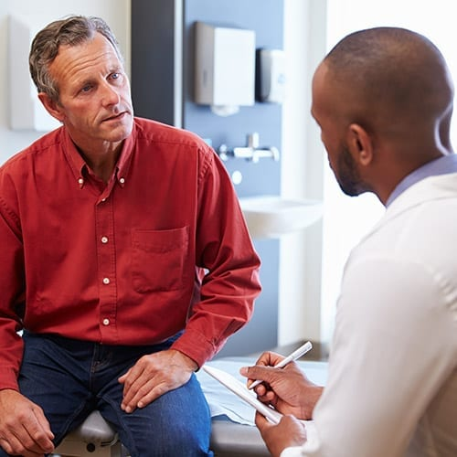 GP consultation - doctor talking to his patient