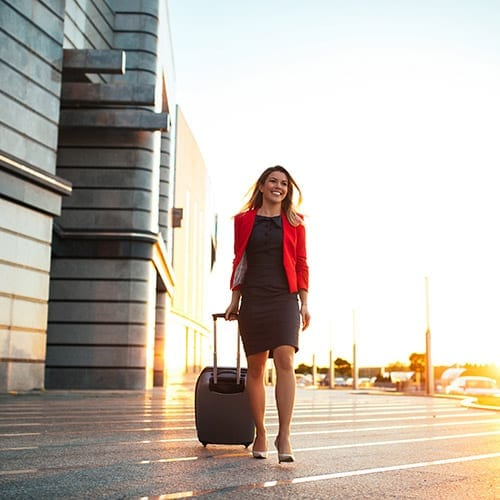 International business woman - woman walking with briefcase