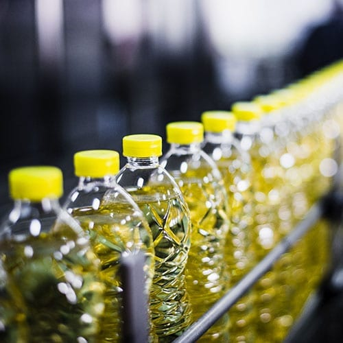 Manufacturing and Engineering image - Sunflower bottles in a warehouse