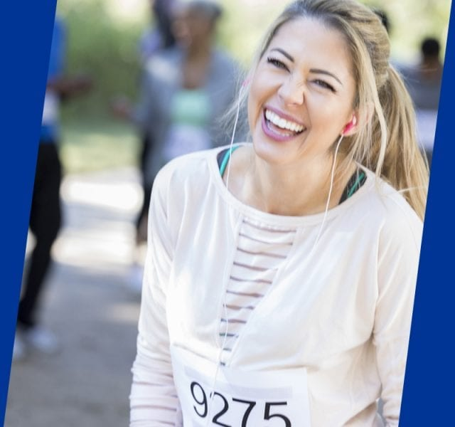 Woman Smiling At A Charity Running Event