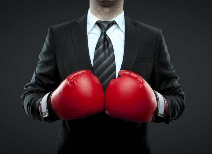 Business Man In Boxing Gloves