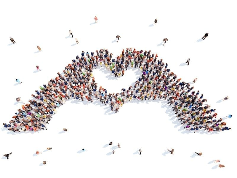 Crowd Of People In Shape Of Hand Heart