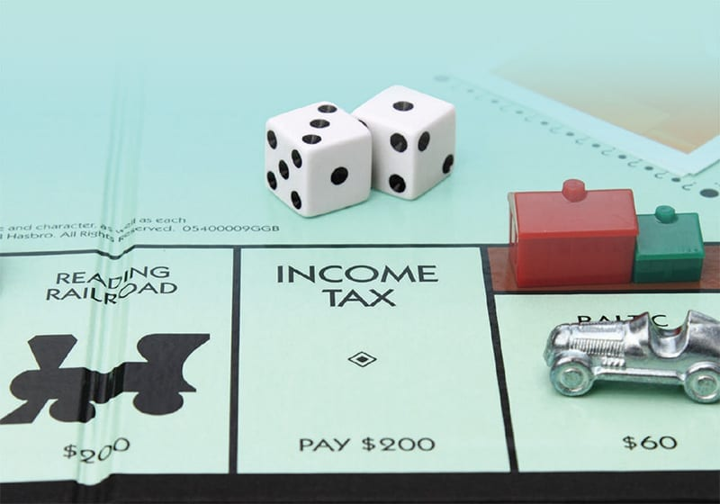 Photo Of Income Tax Square On Monopoly Board