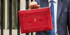 man holding red briefcase