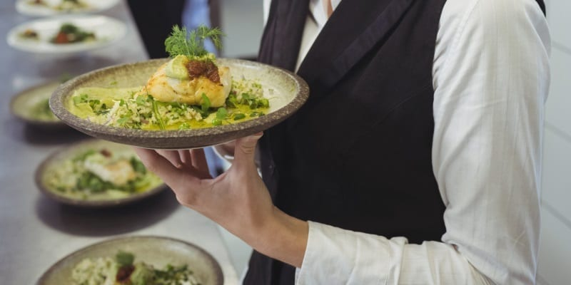 Waiter Holding Plate Of Food