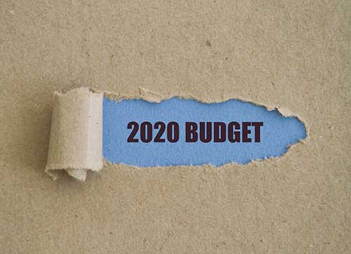 2020 Budget Underneath Ripped Paper