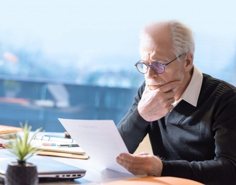 Senior Businessman Reading A Document
