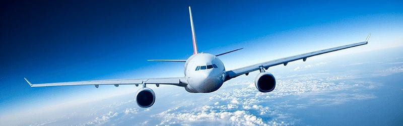 Front View Of Commercial Jet Flying At High Altitude